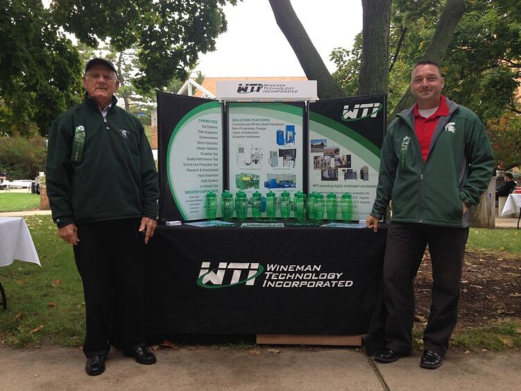 Jim Wineman, CEO, and Kevin Markey, Controls Engineering Manager at WTI, both proud MSU alumni, at the 2014 Engineering Pre-Gallery Co-op/Intern Day.